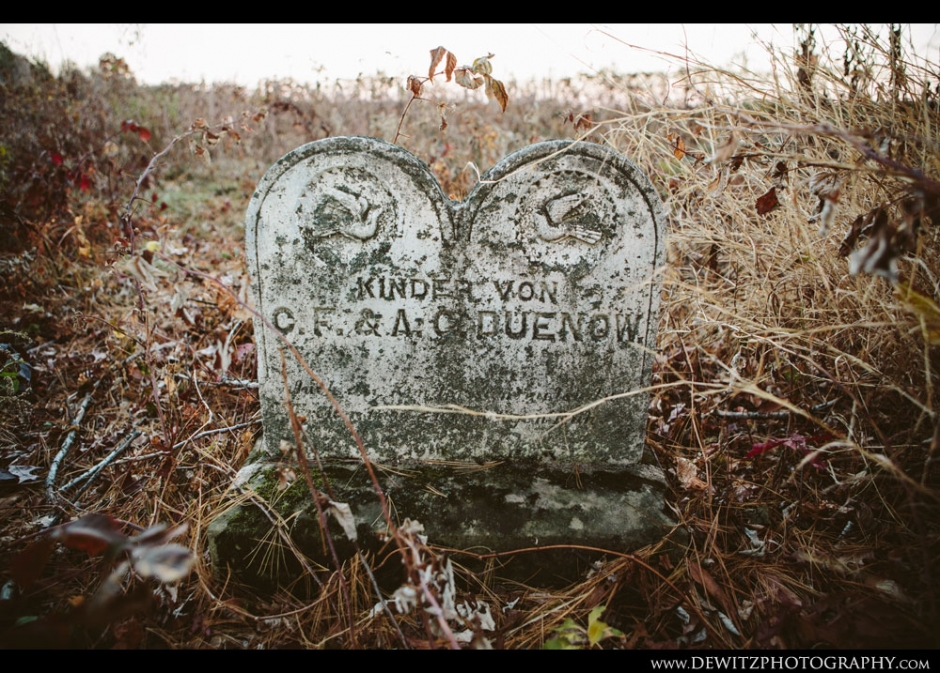 Dual Headstones in Wooded Cemetery