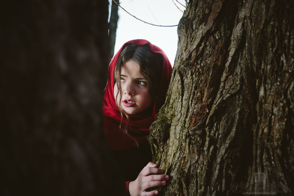 Red Riding Hood Behind a Tree