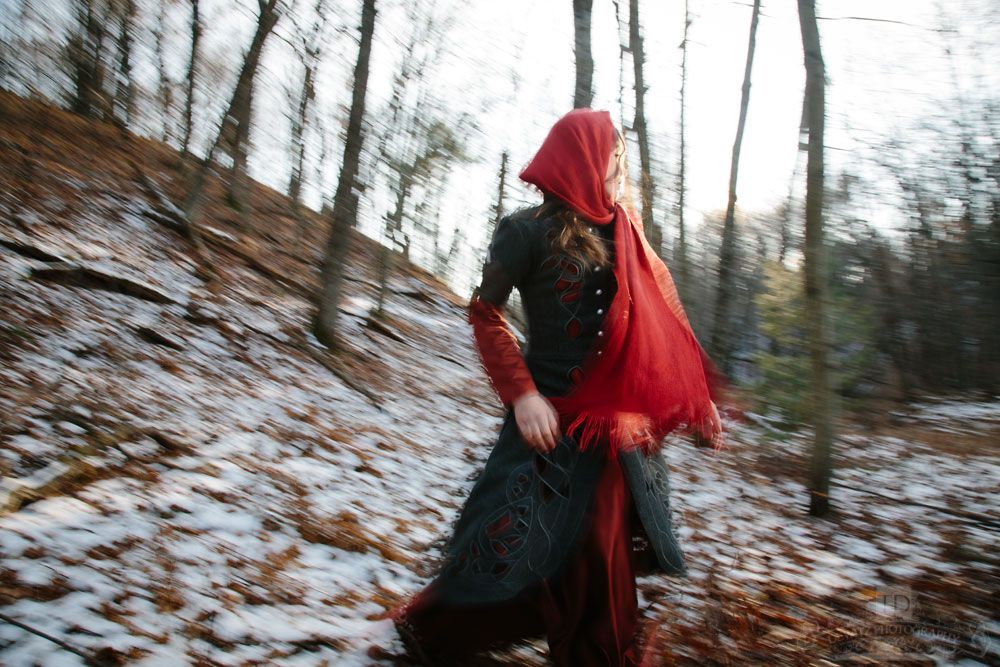 Red Riding Hood Running from Wolf Through the Woods