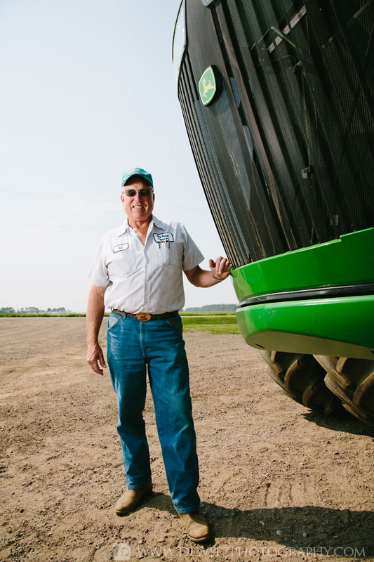 rine_farms_ken_standing_next_to_john_deere_tractor