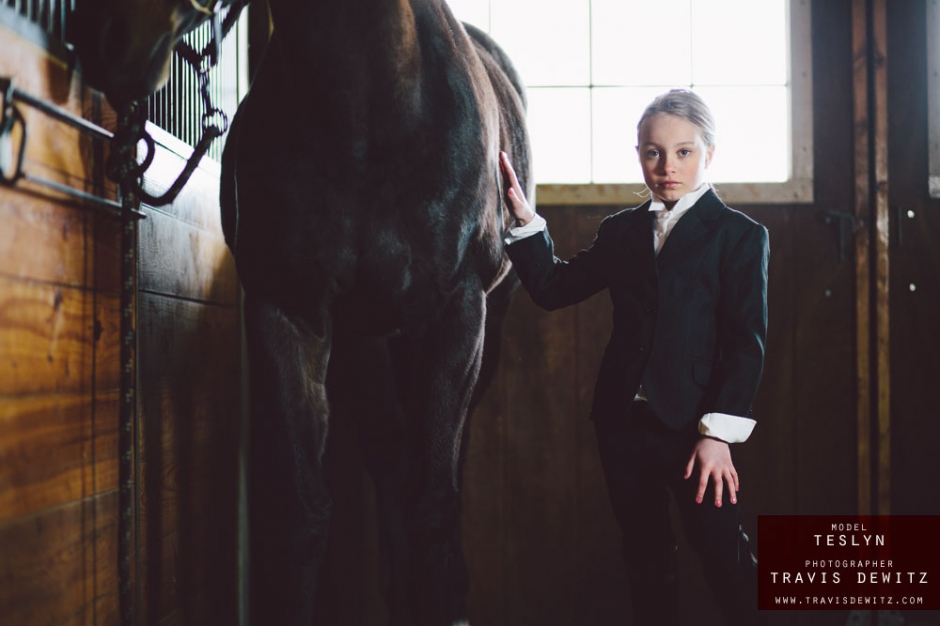 teslyn_english_horse_rider_outfit_in_stable_touching_horse_web