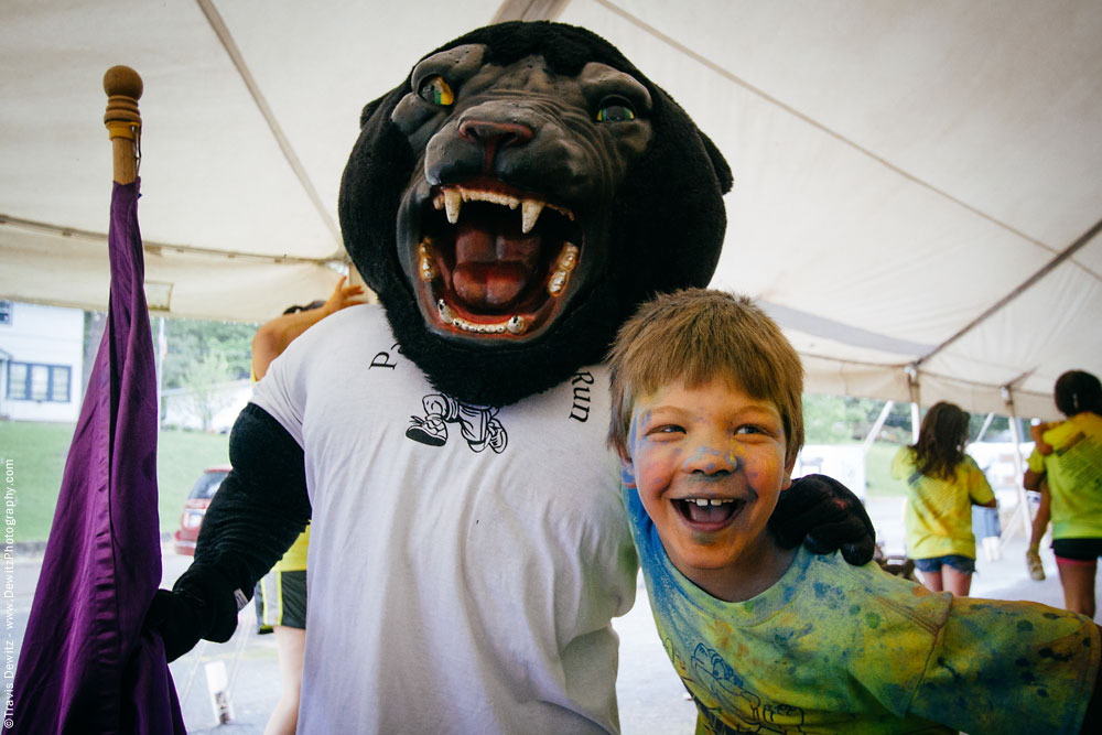 panther_color_run_kid_laughing_with_panther_mascot