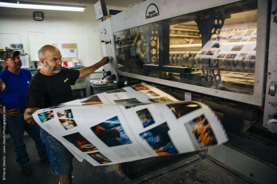 Blaze Orange Book - Worzalla Publishing- Pulling Sheets From the Printing Press