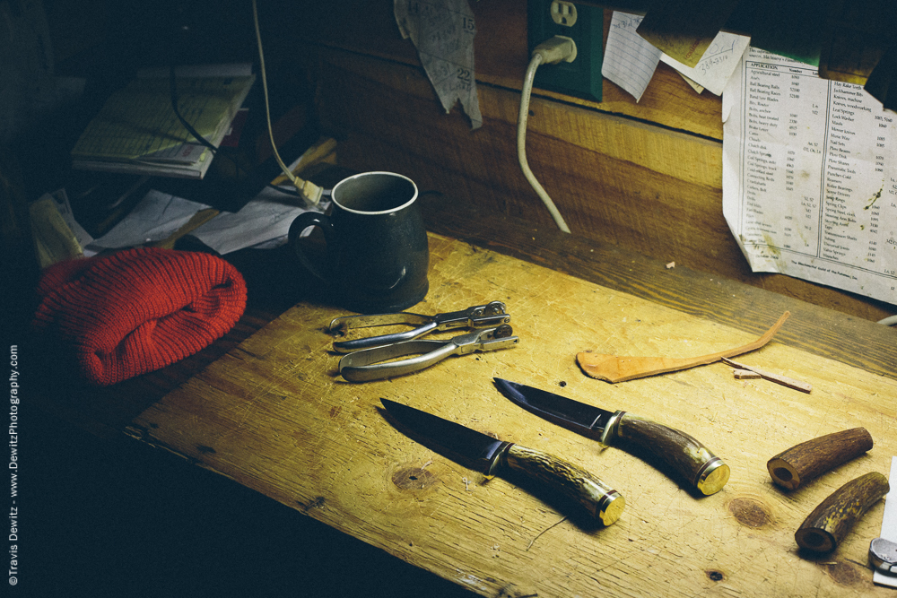 Pair of Hunting Knifes on Bench Along with a Blaze Orange Hat and Coffee Cup