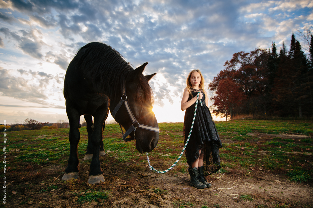 Teslyn - Girl Leading Horse in Field at Sunset
