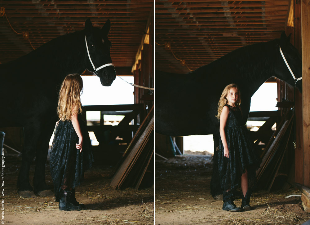 Teslyn - Young Girl in Black Dress in Horse Stable