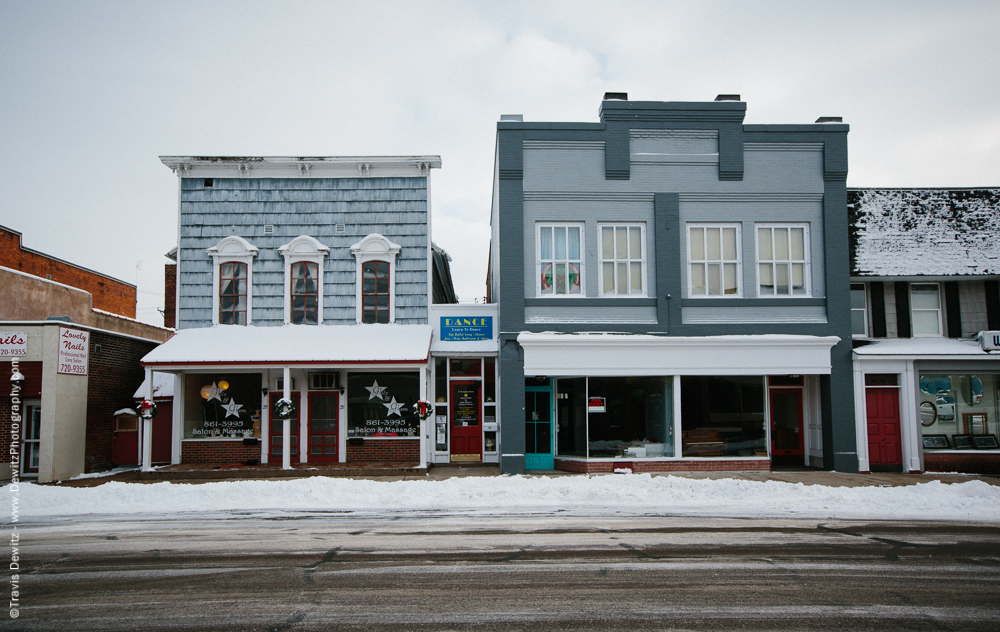 The oldest commercial building left in Chippewa Falls (pictured here on the left) is now blue but still retains its false front. It was built in 1859 by Peter Morie and was the location in the city that citizens would register for the Civil War.
