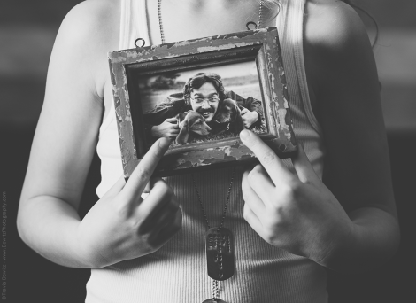 Teslyn Holding Framed Photo of Her Papa Mark with Dogs