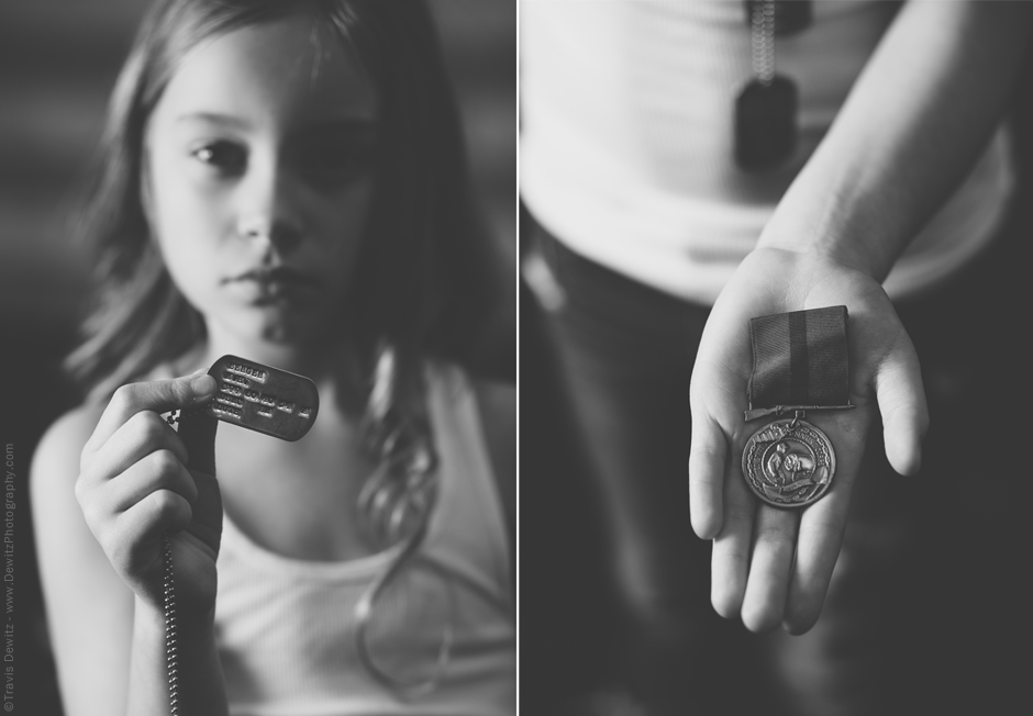 Teslyn holds her Grandpas USMC Dog Tags and War Medal