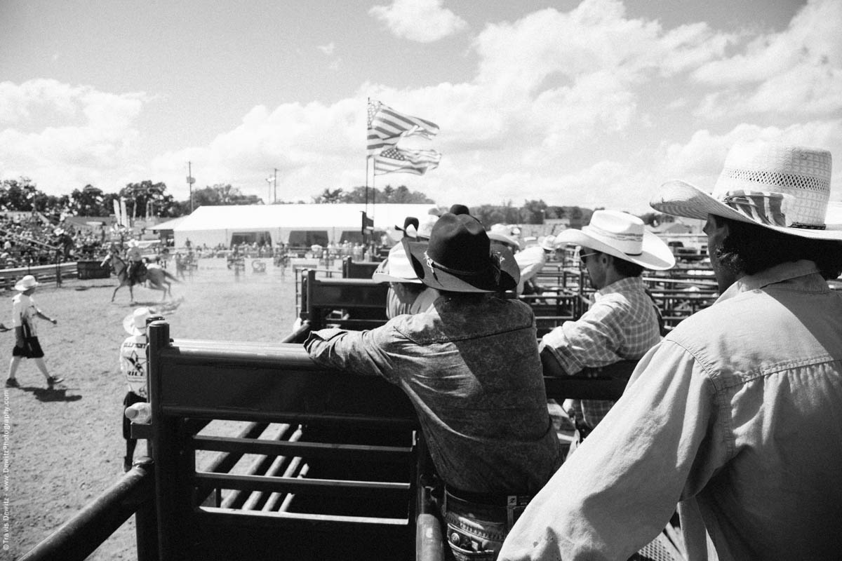 Cowboys Watch over Bull Riding in Arena-3137