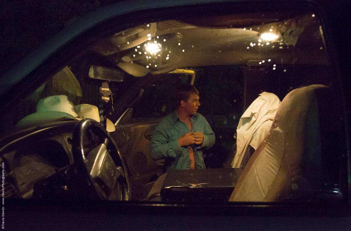 cowboy-changes-in-his-truck-after-wet-rainy-bull-riding-event-at-night-5767