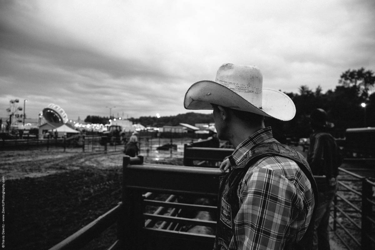 cowboy-looks-out-over-muddy-arena-fair-grounds-4956