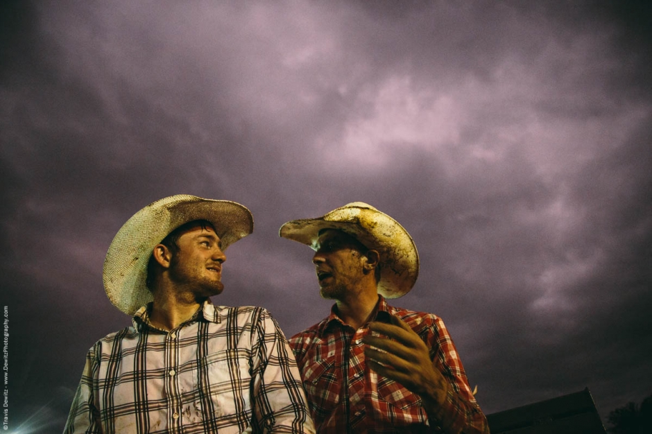 two-cowboys-talk-rodeo-stormy-skies-western-shirts-covered-in-mud-night-5179