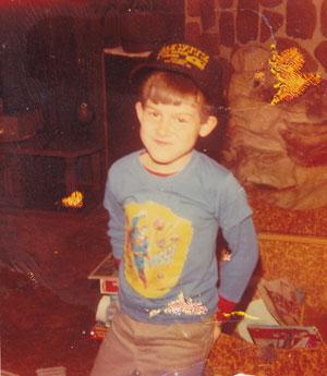 Travis Dewitz as a Child With Dewitz Auto Hat On