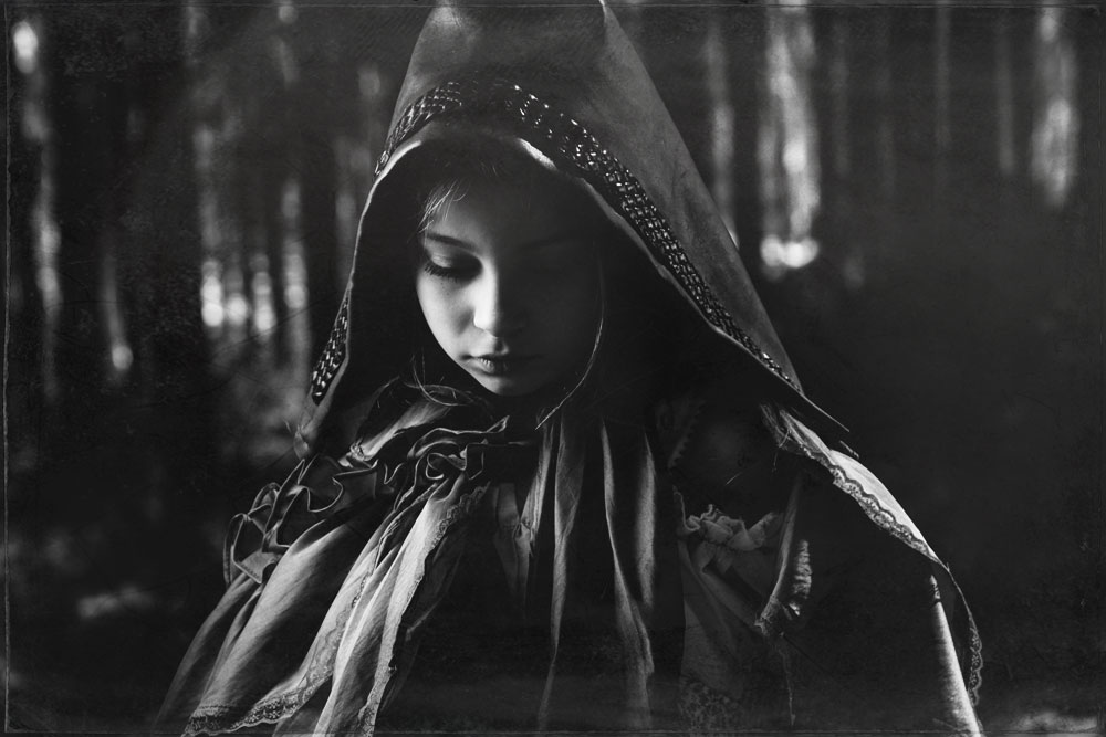 Red Riding Hood Stares Down and Reflects Back Into the Calmness of Her Thoughts