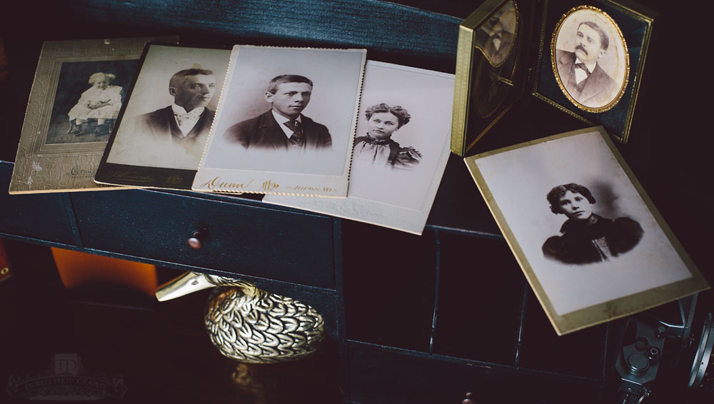 Vintage Caninet Cards on Black Desk With Antique Framed Portraits
