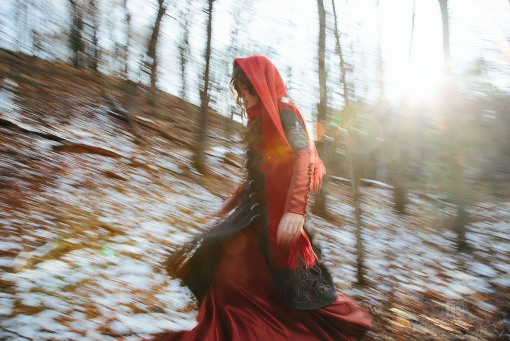 Red Riding Hood on the Move Through the Woods