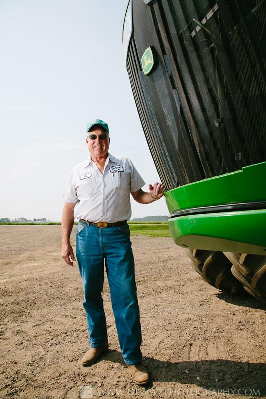 rine_farms_ken_standing_next_to_john_deere_tractor