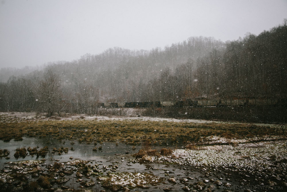coal_train_along_marsh_during_snowfall_web