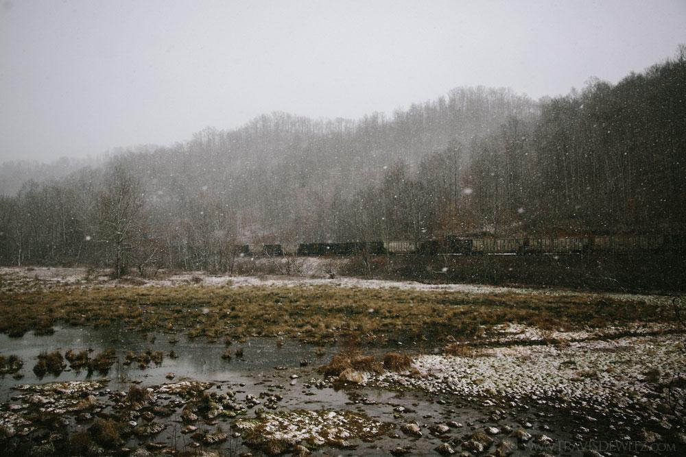 coal_train_along_marsh_during_snowfall_web