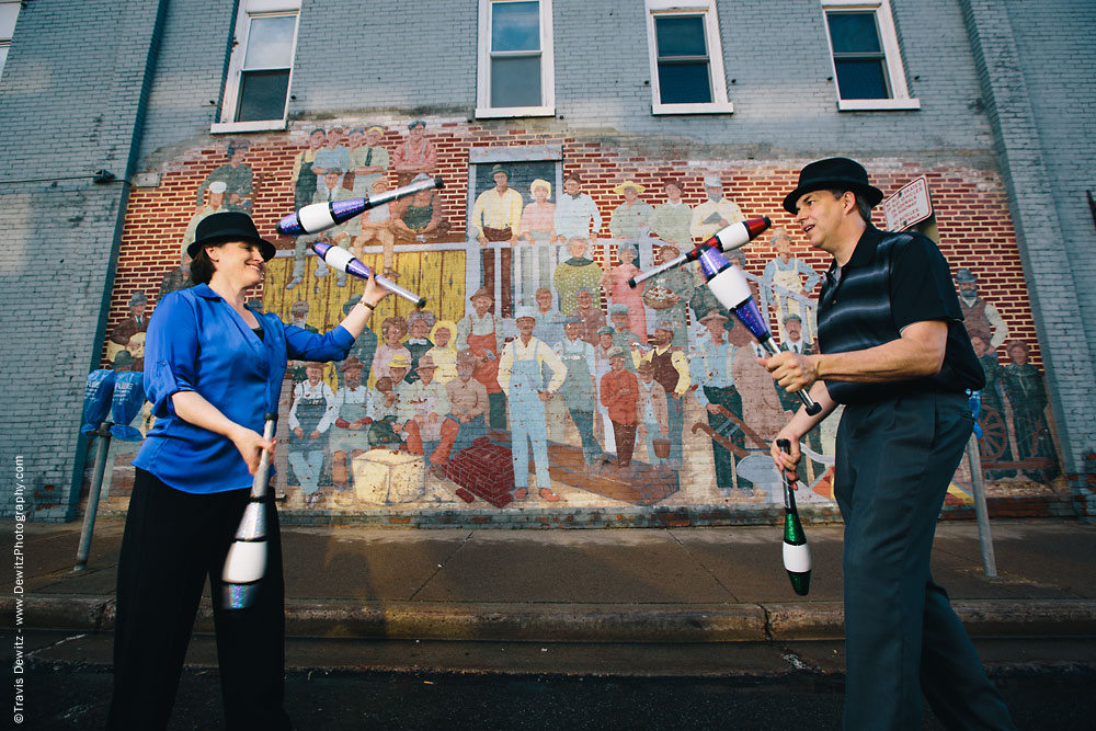 In Capable Hands Juggling in Front of People Painted on Brick Wall in Menomonie Wisconsin