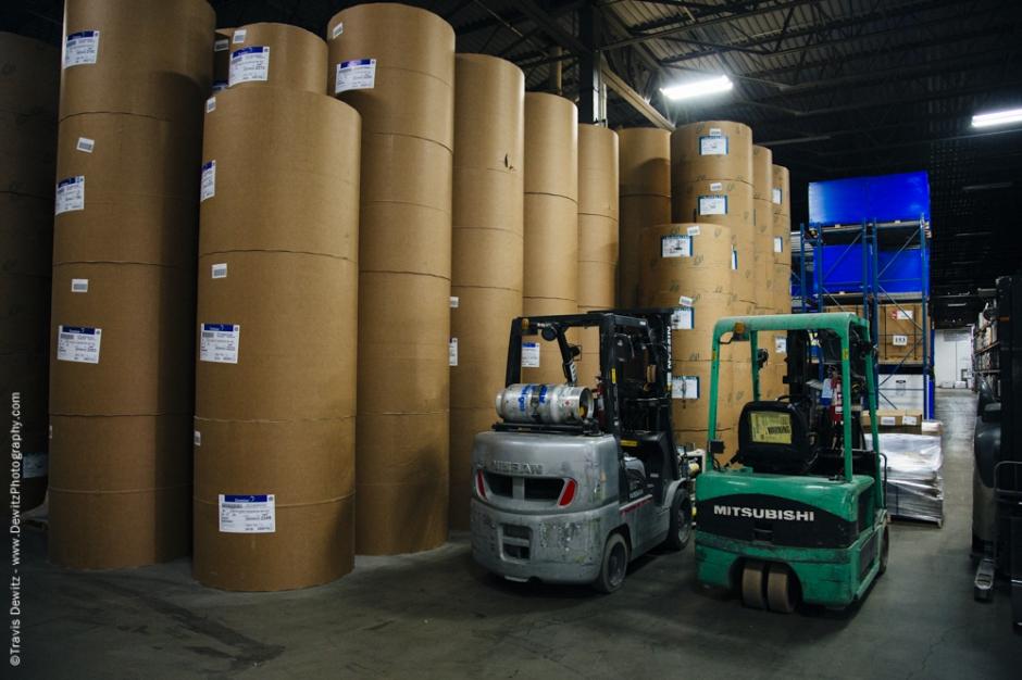 Blaze Orange Book - Worzalla Publishing- Rolls of Paper in Warehouse