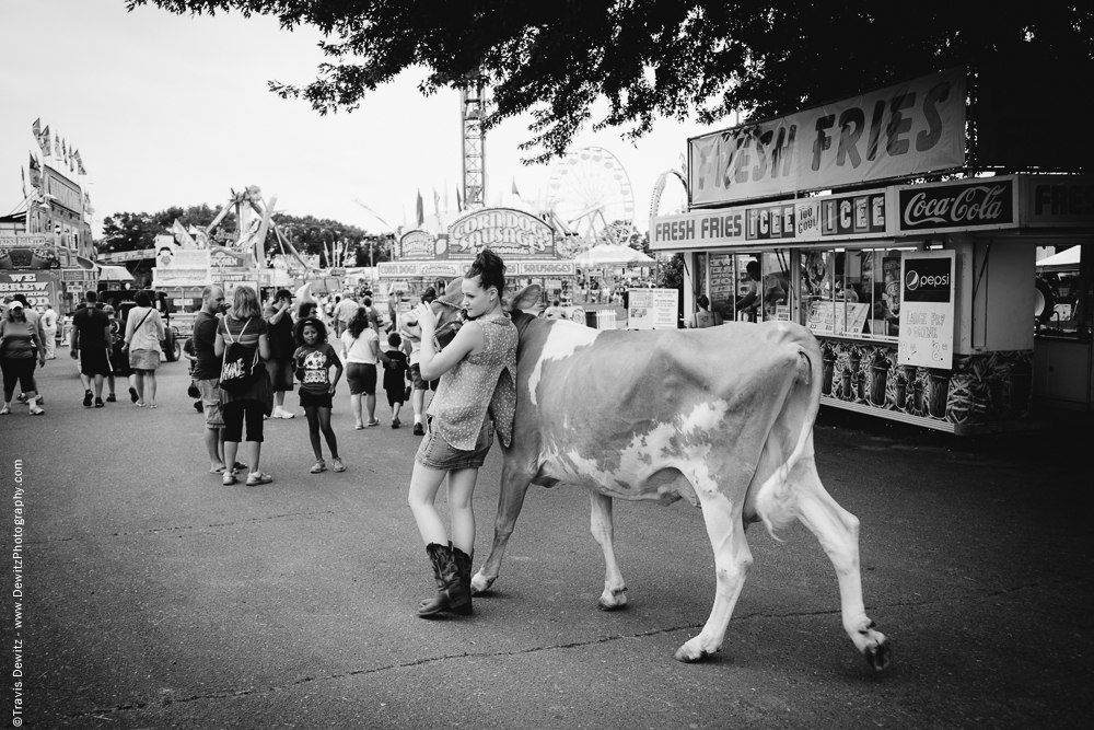 Northern Wisconsin State Fair Girl Walking Her Cow Past Fry Stand