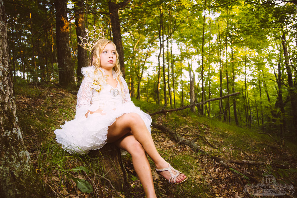 madalina_sitting_on_wooded_hillside_web