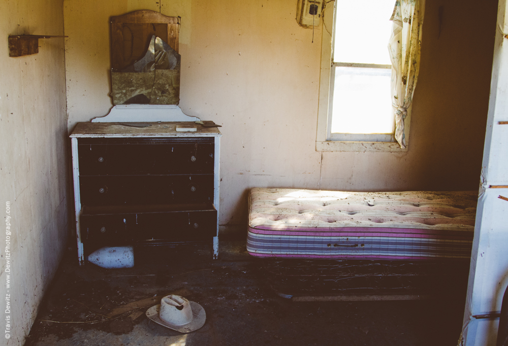 Abandoned Bed Room With Cowboy Hat