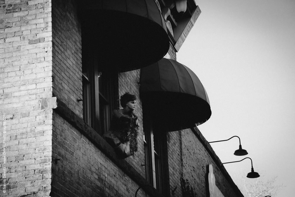 Manikin Hanging Out Window