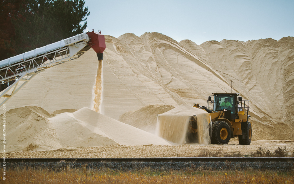 Front End Loader Scooping Sand