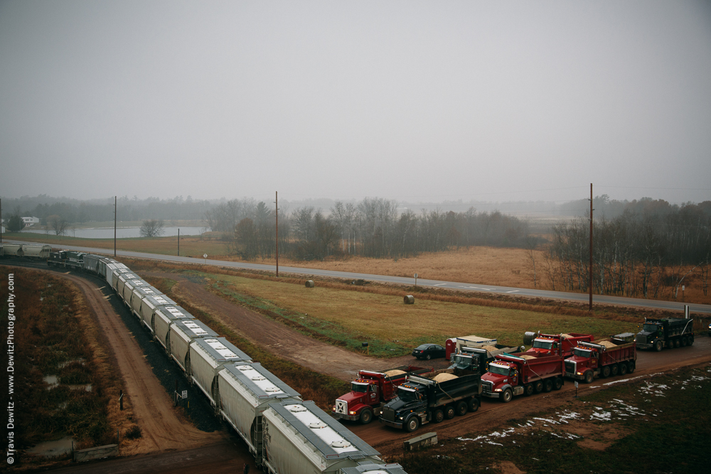 Sand Trucks Wait for Train
