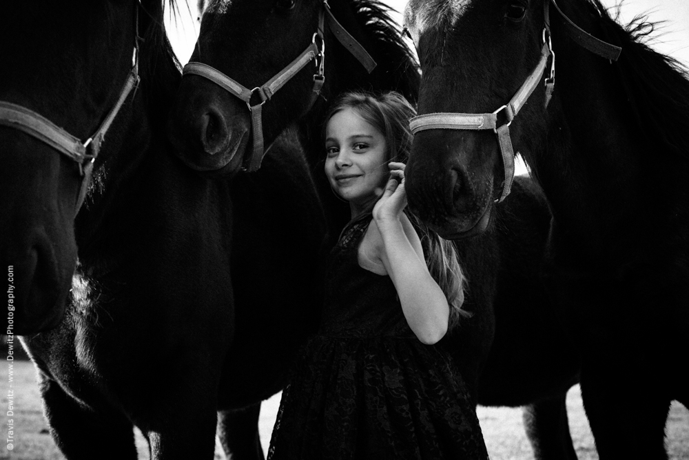 Teslyn - Happy Little Girl in Between Young Horses