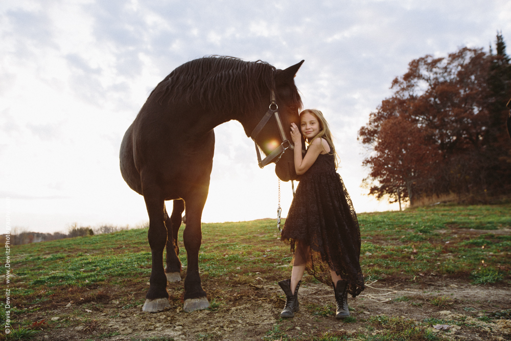 Teslyn - Young Happy Girl Hugging Horse