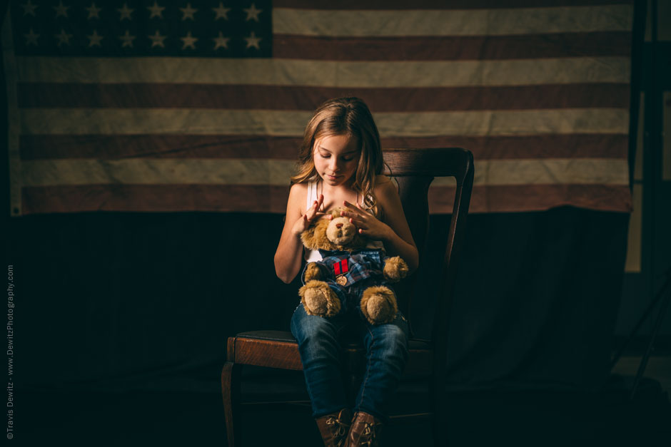 Teslyn Sitting on Antique Chair and Vintage American Flag Holding Teddy Bear