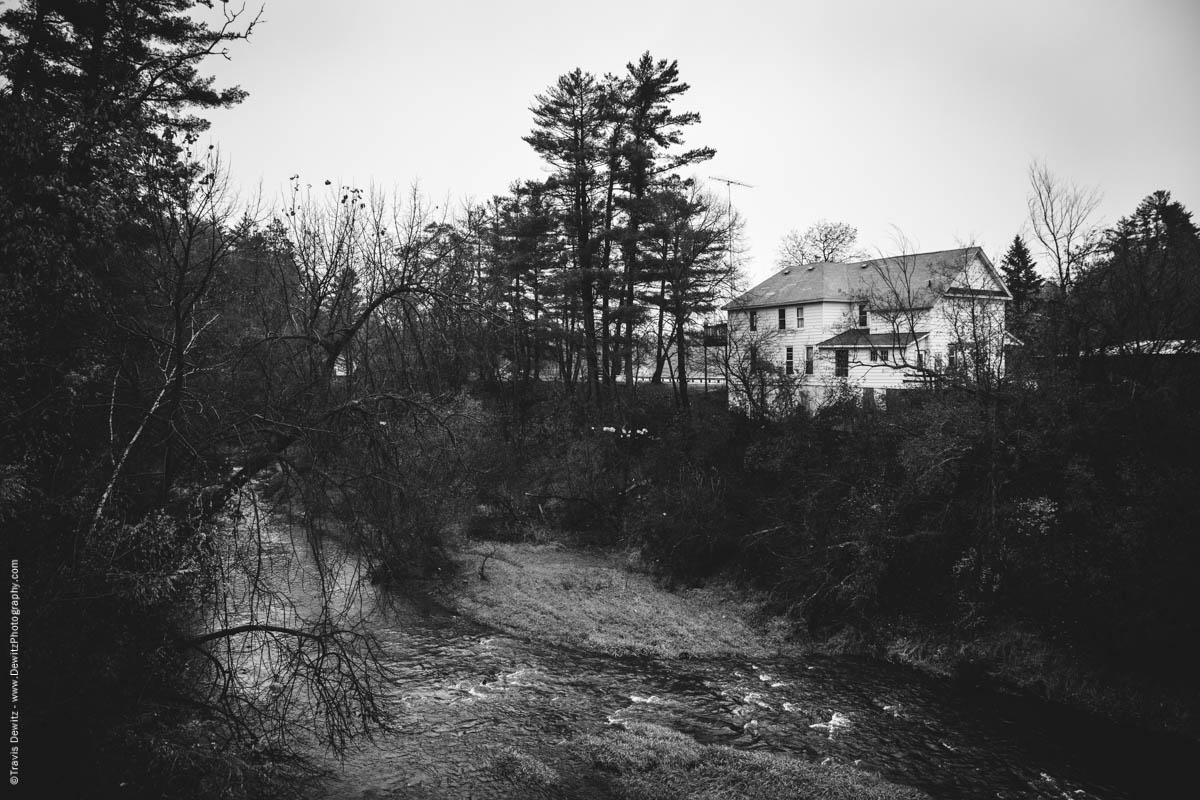 large-old-home-build-overlooking-creek-elk-lake-wi-historic-city