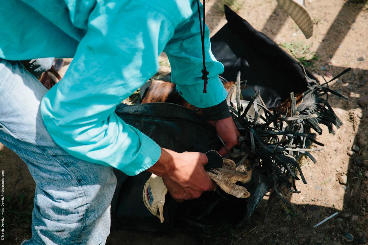 3-Bull Rider Gets Equipment Ready -3033