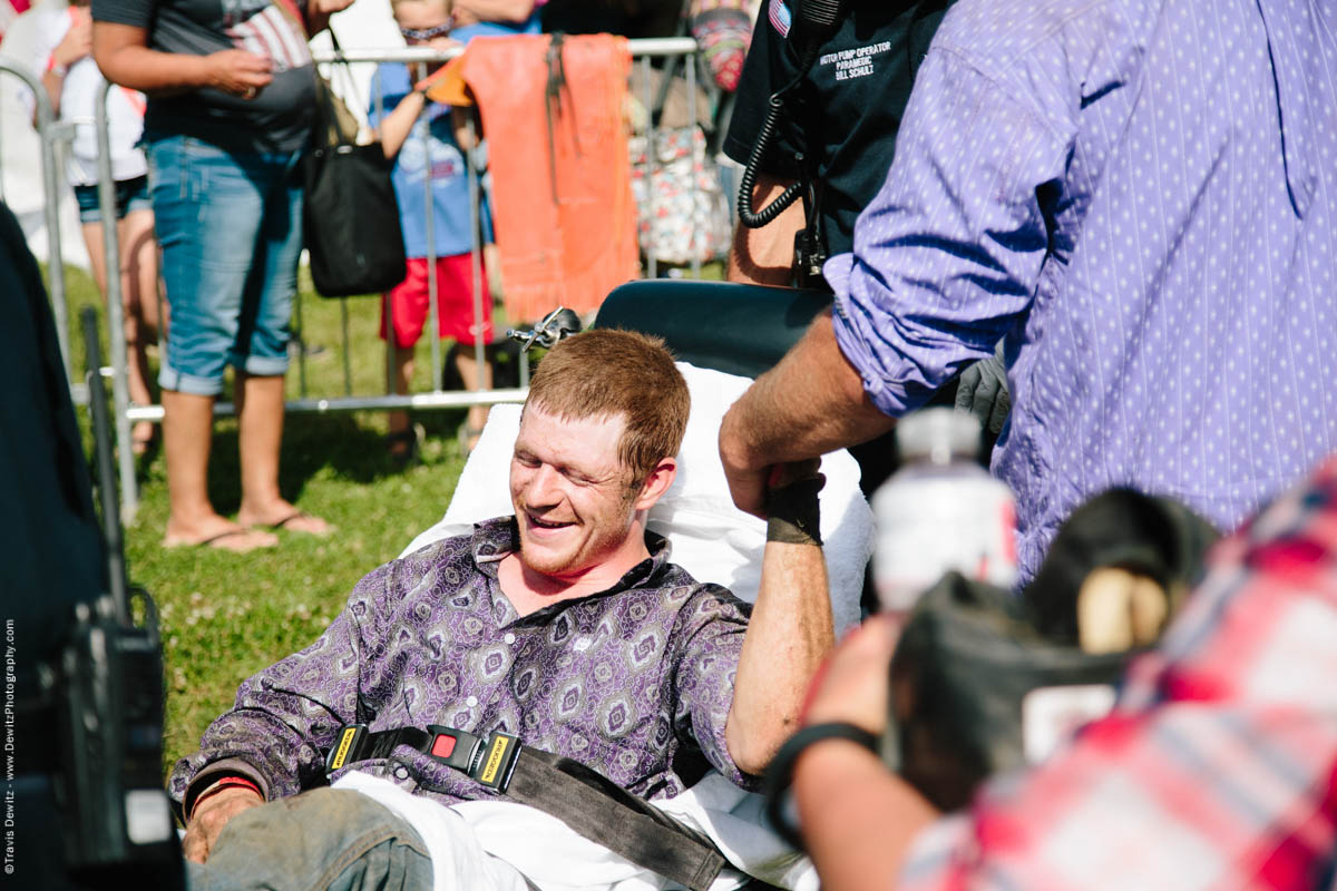 70-Injured Bull Rider on Stretcher Holds Friends Hand-3386