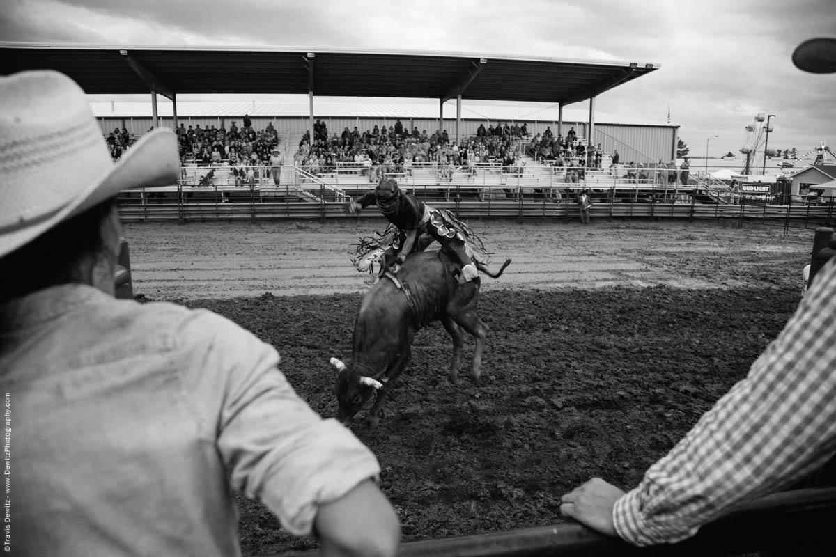 bull-rider-flies-in-air-jackson-county-fair-mud-4705
