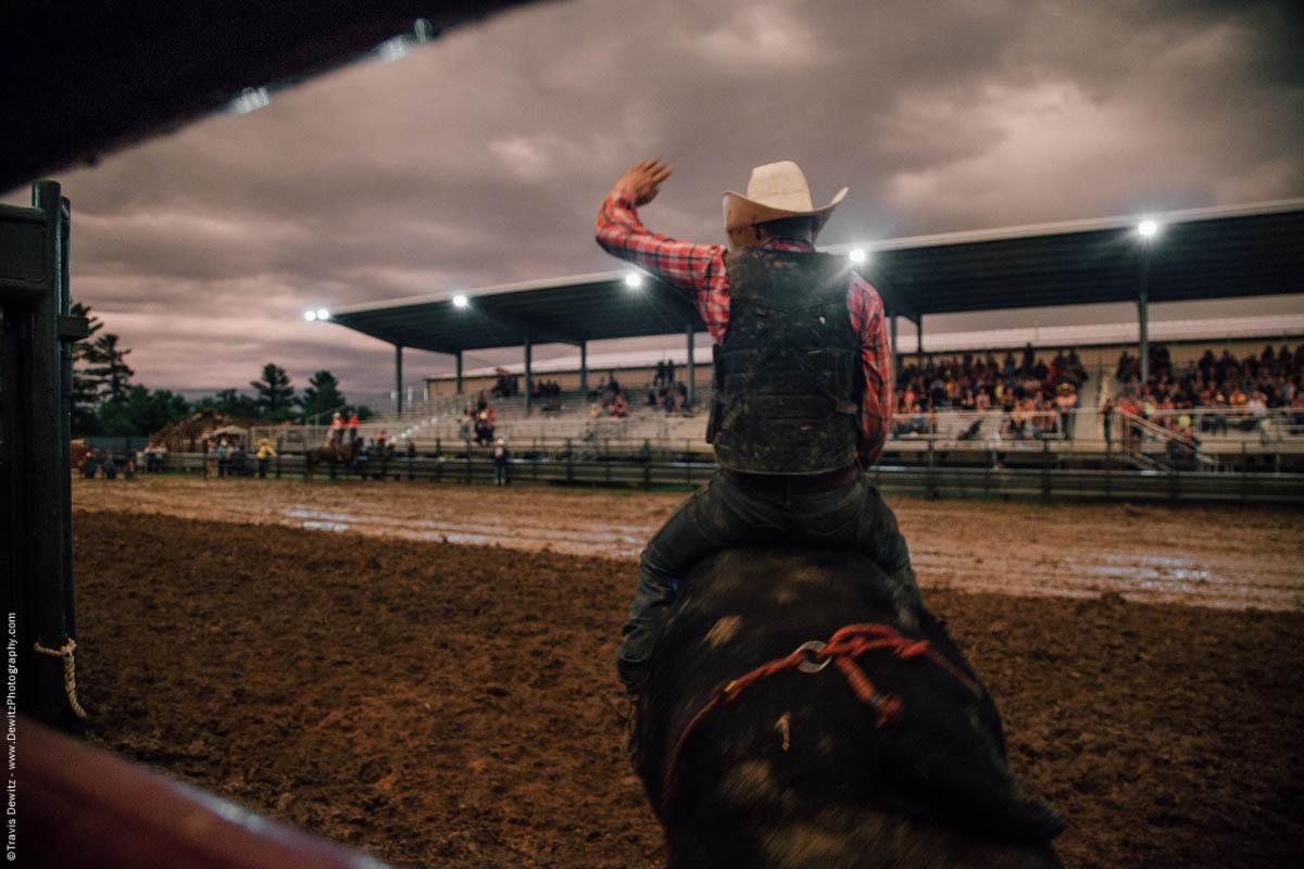 bull-rider-on-bucking-bull-hand-up-5083
