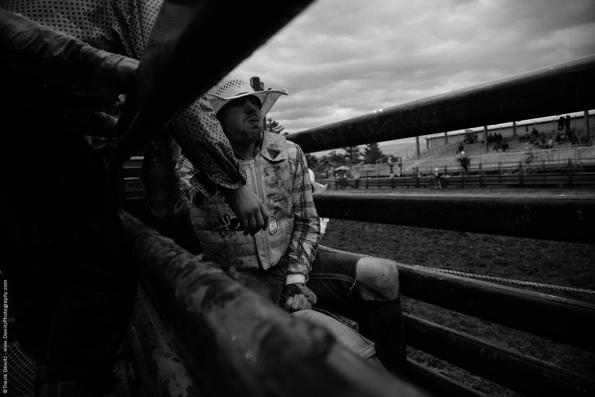 bull-rider-prepares-to-exit-chute-on-bull-5003