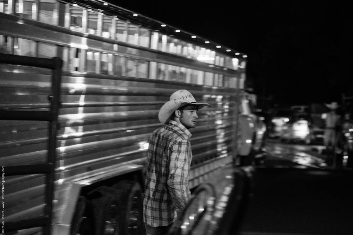 cowboy-walks-past-cattle-trailer-5715