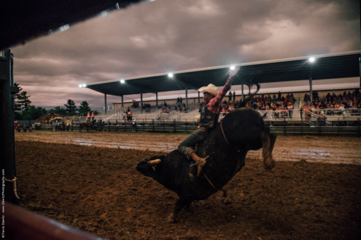 eight-second-bull-ride-arm-up-muddy-arena-5086