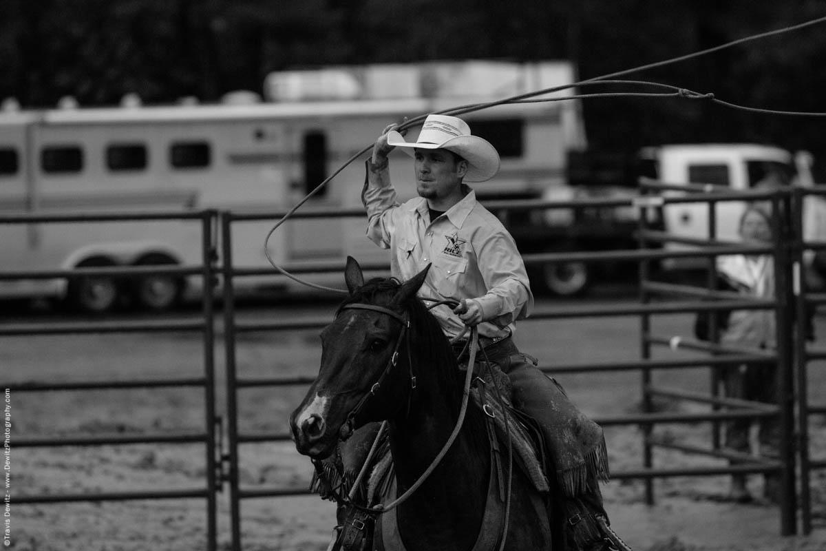 rice-bull-riding-cowboy-swings-lasso-on-horse-7651