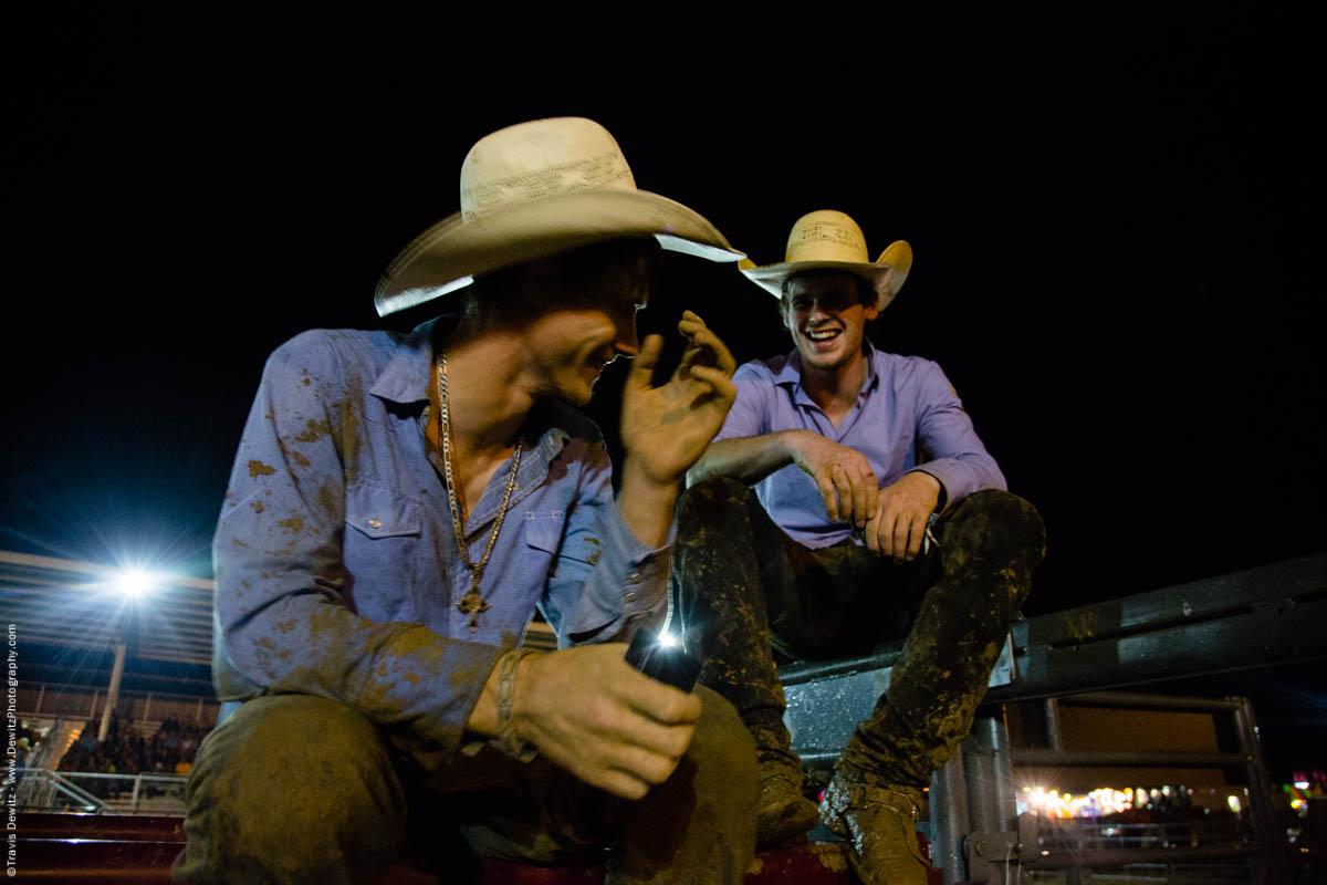 two-cowboy-friends-joke-around-covered-in-mud-5599